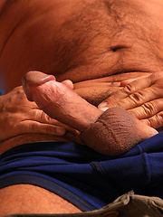 Older gay man demonstrates his hard dick
