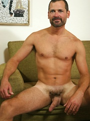 Older gay man bares his hairy cock
