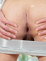Sexy blonde Lukas Watkins rubs his ass and strokes his cock.