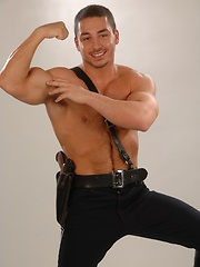 Police man posing in leather clothes