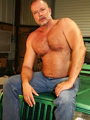Rough and tough muscle bear Alex Payne peels off his clothes and shows off his sexy body