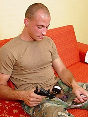 A very soft spoken military boy uses toy before camera