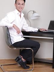Joseph Sydney stroking his cock at his desk.